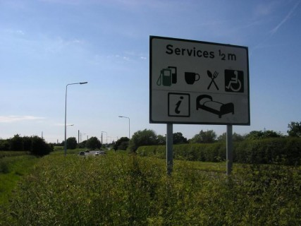 Sign for  Chester Services  on the A5117 427x320